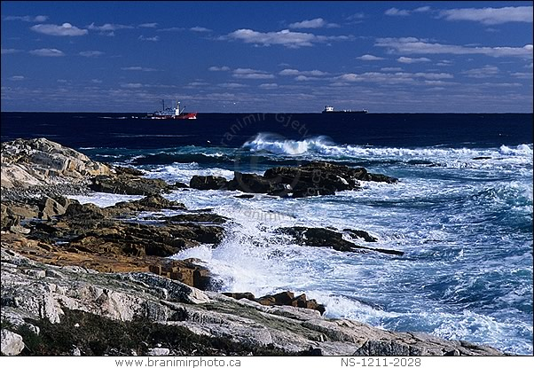 image  boats near rocky shoreline after storm  nova scotia